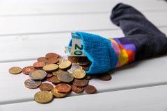 Socke voll mit Eurogeld Stockbilder