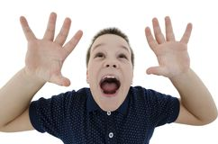 Socked boy looking up with his hands up. Isolated on white background Stock Photo