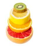 Sockeln av frukterna fallande frukt, grapefrukt, kiwi, citron arkivbilder