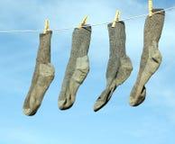 Socken auf der Zeile Stockfotos