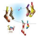 Socken auf einem Seil Stockbilder