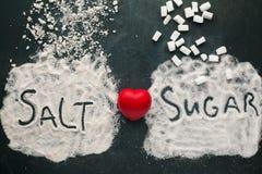 Socker och salt kommer med skada till hjärtan Arkivbild