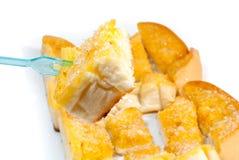 Socker- och smörrostat bröd mot bakgrund Fotografering för Bildbyråer