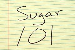 Socker 101 på ett gult lagligt block Royaltyfri Bild