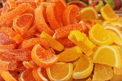 Sockergodisar i formen av skivor apelsin och citron Arkivbild