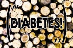 Sockersjuka för textteckenvisning Kronisk sjukdom för begreppsmässigt foto som förbinds till höga nivåer av sockerglukos i träblo fotografering för bildbyråer