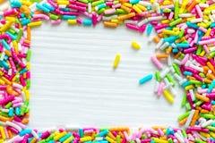 Sockerstänkprickar, garnering för kaka och bageri Arkivfoto