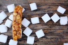 Sockerstång med sesam och jordnöten Arkivfoton