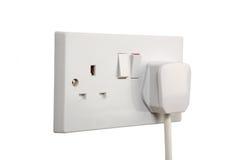 Socket on. British socket and plug. Socket turned on. isolated on white stock photos