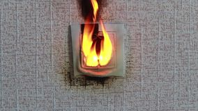 Socket close-up. The fire was caused by a short circuit. Electric short curcuit. the fire is real.  stock video