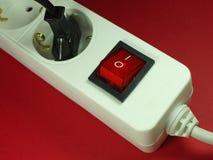 Socket delante del fondo rojo Imagen de archivo libre de regalías