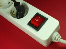 Socket in front of red background Royalty Free Stock Image