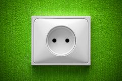 The socket in a green wall Royalty Free Stock Images