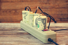 Socket and money. Concept of energy savings Royalty Free Stock Images