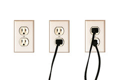 Socket plugged and unplugged. Close up of socket and its three versions: on its own, with one plug, with 2 plugs royalty free stock photography