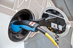 Socket and power cable on electric car.  stock photography