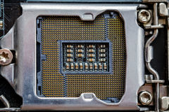 Socket for processor or cpu, top view, macro photo. Electronic computer hardware. Technology. Motherboard digital chip. Tech science background Stock Photography
