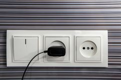 Socket with recharging device Stock Image