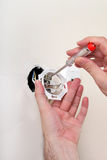 Socket repair. Man is repairing a wall socket royalty free stock photos