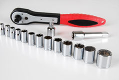 Socket set. Various sizes of sockets and handle Stock Image