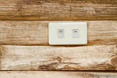 Socket on the wood wall Royalty Free Stock Image