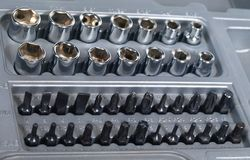 Socket wrench and screwdriver bit set stock images