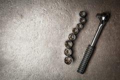 Socket wrench set. On dark stone background stock images
