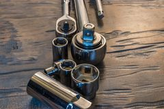 Socket wrenches and sockets. In a pile Royalty Free Stock Photos