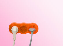 Sockets with inserted power plugs Royalty Free Stock Images