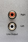 Sockets of the line output on an aluminum panel. Royalty Free Stock Photo