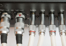 Sockets and plugs of the inputs and outputs on an black metal panel. Stock Images