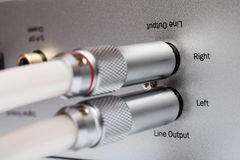 Sockets and plugs of the line output on an aluminum panel. Royalty Free Stock Image