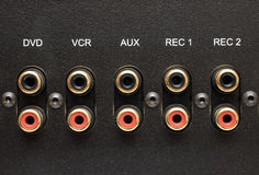 Sockets of various inputs on an black metal panel. Royalty Free Stock Photos