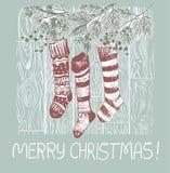 Sockor framlägger det blåa rosa traditionella vektorkortet för jul vektor illustrationer