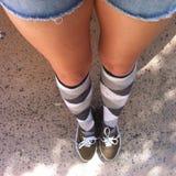 Sockor och gymnastikskor Royaltyfri Foto