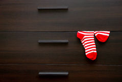 Socks. Вrown chest and striped socks Royalty Free Stock Images