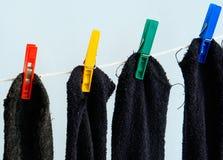 Socks. Four drying socks.Four colours Stock Photos