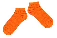 Socks. A pair of orange socks stock photography