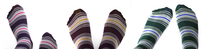 Socks. Beautiful legs in funny socks over white Royalty Free Stock Images