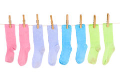 Socks. A row of clean sock hanging on a clothesline Stock Image