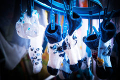 Socks and baby clothes Stock Images