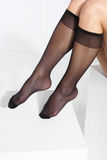 Socks. Beautiful, leggy woman in thin tights and fashionable styling Royalty Free Stock Image