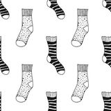 Socks. Black and white seamless pattern for coloring book and page. Knitted clothes. Vector illustration Stock Images