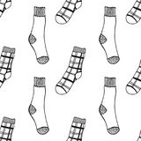 Socks. Black and white seamless pattern for coloring book and page. Knitted clothes. Vector illustration Stock Photo
