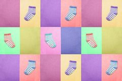 Socks for children. View from above. Multi-colored striped socks on pink, mustard, purple, violet and green backgrounds. Abstract. Seamless texture in the style Royalty Free Stock Image