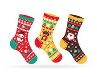 Socks with Christmas symbols Snowman Santa with reindeers Stock Photo
