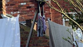 Socks Close Up - Washing Line - Socks, Sheets, Clothes & Towels Hanging in Victorian House Garden stock footage