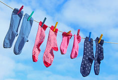 Socks on a clothesline against blue sky Royalty Free Stock Image