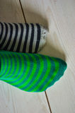 Socks. Diffenrently socks with lines in green and grey on a white wooden ground stock photo