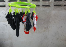 Socks drying. Could someone please Translate Stock Photo
